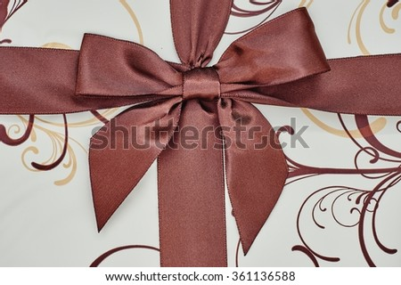 A studio photo of a gift with a bow