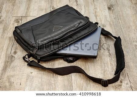 A studio photo of a laptop shoulder bag - stock photo