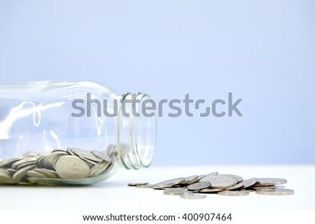 A studio photo of a money jar - stock photo