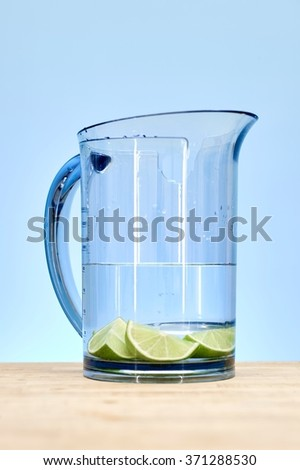 A studio photo of a tall water jug