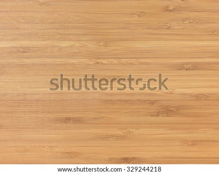 A studio photo of a wooden bamboo background - stock photo