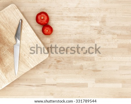 A studio photo of a wooden cutting board - stock photo