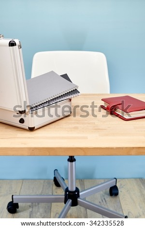 A studio photo of a workplace office desk