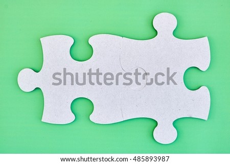 A studio photo of cardboard jigsaw pieces