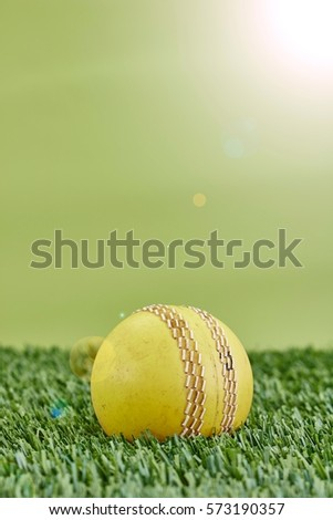 A studio photo of cricket gear on grass