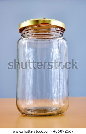 A studio photo of glass storage jars