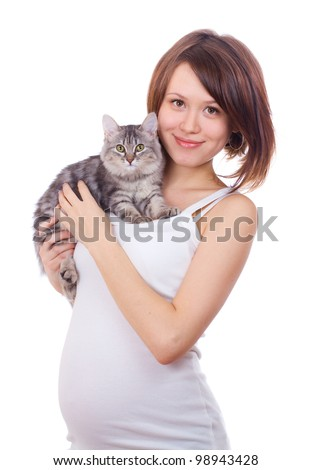 a studio portrait of an attractive pregnant woman holding a cat in her hands isolated on white background - stock photo