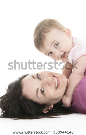 A Studio Portrait Of Mother With Young Baby girl