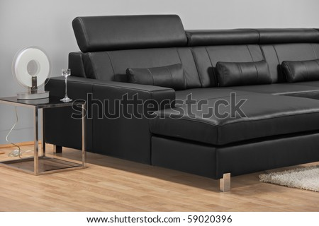 A studio shot of a black leather furniture - stock photo