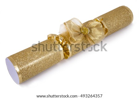 A studio shot of a Christmas Cracker or otherwise known as a Bon Bon.  A cracker consists of a cardboard tube wrapped in a brightly decorated twist of paper with a gift in the central chamber.