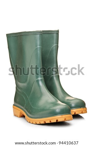 A studio shot of a green rubber boots isolated on white background - stock photo