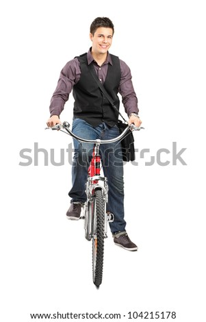 A studio shot of a man riding a bike isolated against white background - stock photo