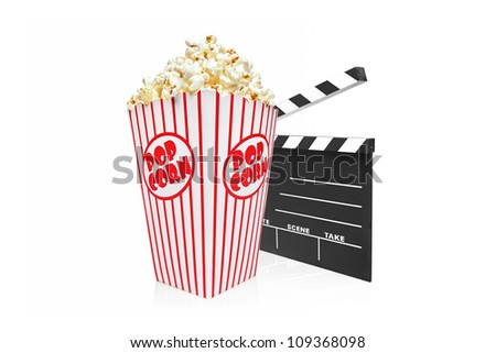 A studio shot of a movie clap and popcorn box isolated on white background - stock photo