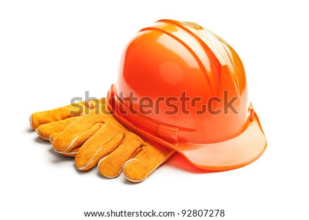 A studio shot of a standard construction safety equipment, helmet and gloves, isolated on white background - stock photo