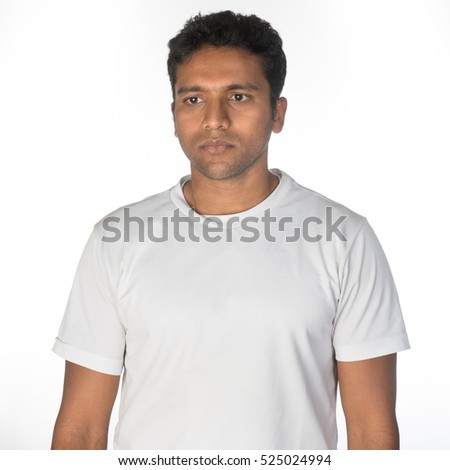 A studio shot of a thoughtful Indian South Asian young man looking off-camera