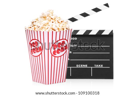 A studio shot of an open movie clap and popcorn box isolated on white background - stock photo