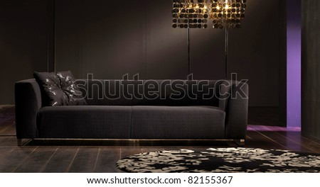 A studio shot of black sofa - stock photo