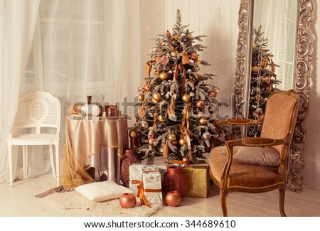 a stylish interior with elegant Christmas tree decorated.