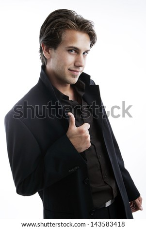 A stylish man with thumbs up sign on white