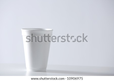 a stypherome cup of coffee on a desk at the office - stock photo