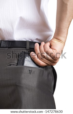A successful business man pulling out his wallet from the pocket - stock photo