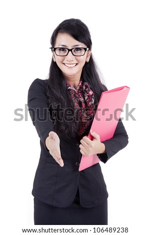A successful business woman stretches out her hand to shake hands with someone - stock photo