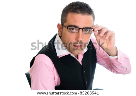 A successful businessman with glasses wearing vest and pink shirt - stock photo