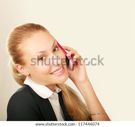A successful businesswoman talking on the phone - stock photo