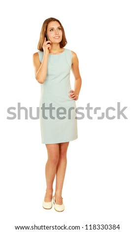 A successful businesswoman talking on the phone, isolated on white - stock photo
