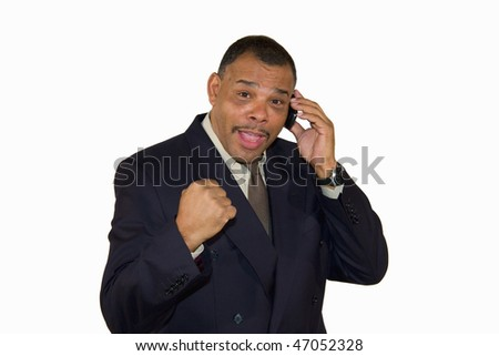 a successful mature African-American businessman with a cell phone raising his fist, isolated on white background - stock photo
