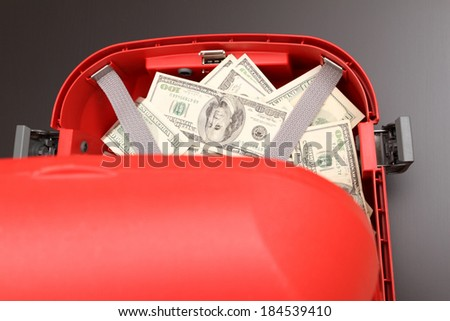 A Suitcase with lots of dollars  - stock photo