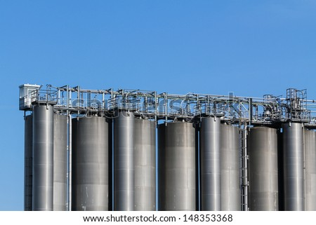 A suite of gas tanks on an industrial field outside Vienna, Austria