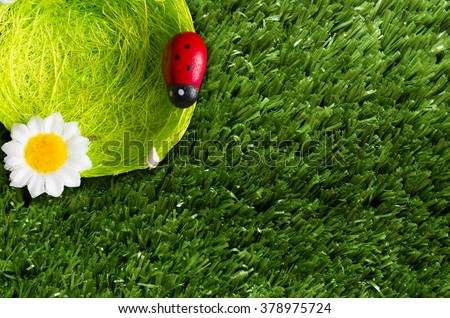 A summer background with a nest, ladybugs, grass. - stock photo