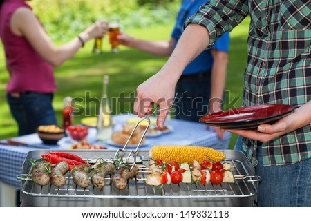 A summer garden party with grilled snacks and drinks - stock photo