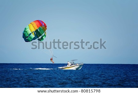 A summer sport - parasailing and boat