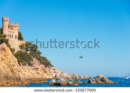 A summer sport - parasailing in Lloret del Mar - stock photo