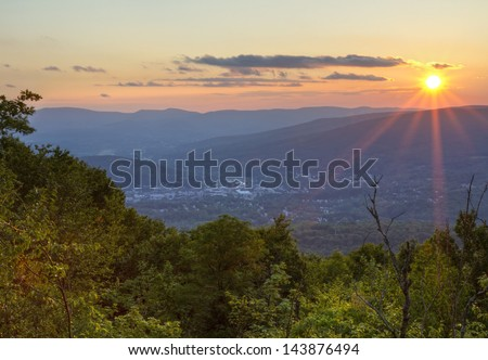 A Summer sunset overlooking North Adams, Masachusetts in the Berkshires. - stock photo