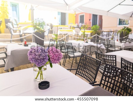 a summer terrace of traditional European Mediterranean restaurant - stock photo