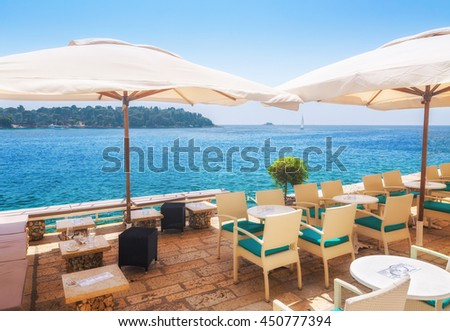 a summer terrace seaside view of traditional european mediterranean restaurant - stock photo