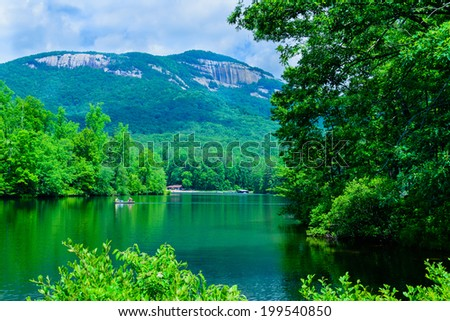 A summer view of Table Rock mountain and a nearby lake in the mountains of South Carolina, USA. - stock photo