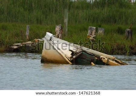 A sunken boat rests in the inlet at Tangiers, Virginia - stock photo
