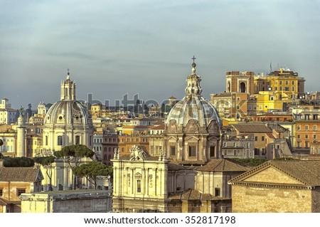 A sunlit cityscape of the Italian capital of Rome. - stock photo