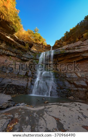 A sunny Autumn afternoon at Kaaterskill Falls  Catskills Mountains of New York. - stock photo