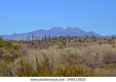 A sunny winter day, looking across wooded ridges towards the Four Peaks in Tonto National Forest, Arizona.  - stock photo