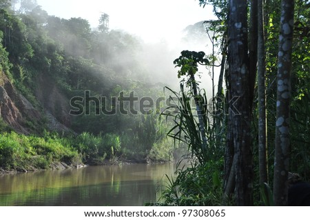 A sunrise along the Tambopata River in the Peruvian Amazon - stock photo