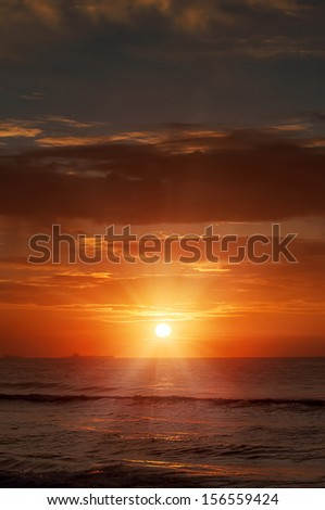 A sunrise in the sea  - stock photo
