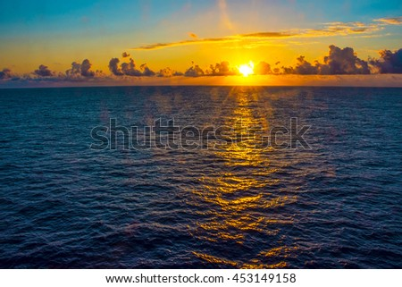 A sunrise view from a cruise ship on the North Atlantic. - stock photo