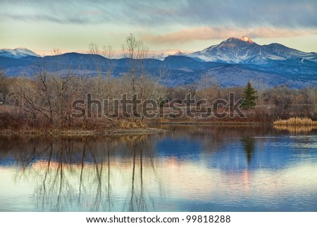 A sunrise view of Longs Peak at golden ponds in Longmont Colorado, Boulder County. - stock photo