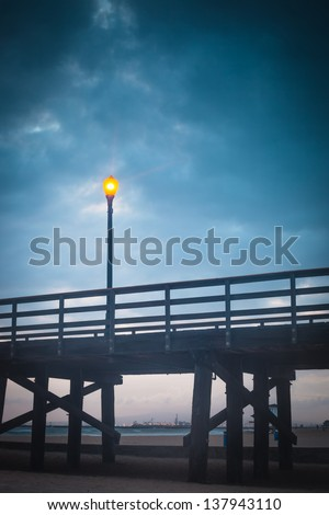 A sunset shot of the Seal Beach pier. - stock photo