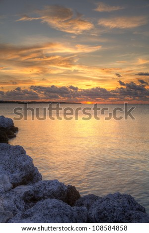 a sunset taken at the key west island, with foreground stones - stock photo